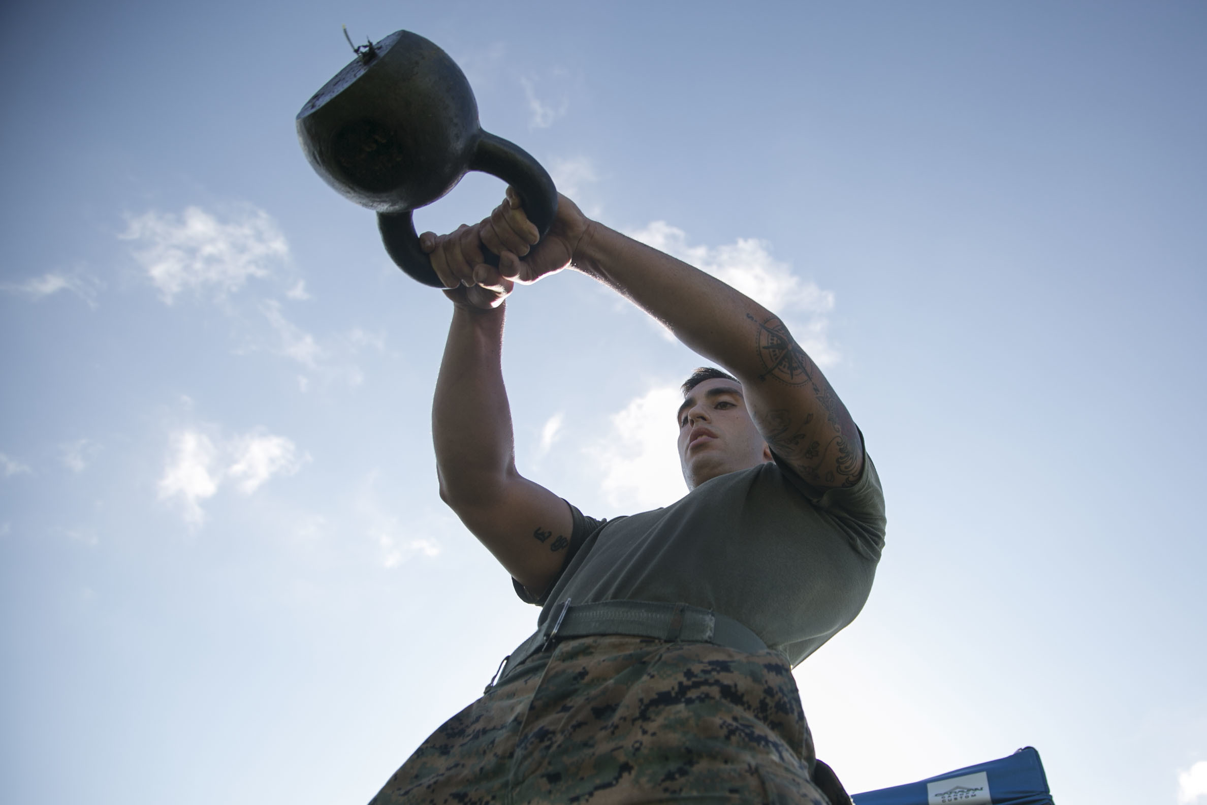 "Sgt. Harold S. Johnson performs a kettlebell swing while competing in a High Intensity Tactical Training competition June 17 aboard Camp Foster, Okinawa, Japan. Marines battled to see who could get the best time on three challenging events, which consisted of exercises such as kneeling power ball throws, kettlebell carries and burpees. The top male and female participants from the competition will travel to Marine Corps Air Station Miramar, California to compete in the HITT Championship to claim the title ""Ultimate Tactical Athlete."" Johnson is a combat videographer with Headquarters and Service Battalion, Marine Corps Installations Pacific-Marine Corps Base Camp Butler, Japan. (U.S. Marine Corps Photo by Cpl. Douglas Simons/Released)"